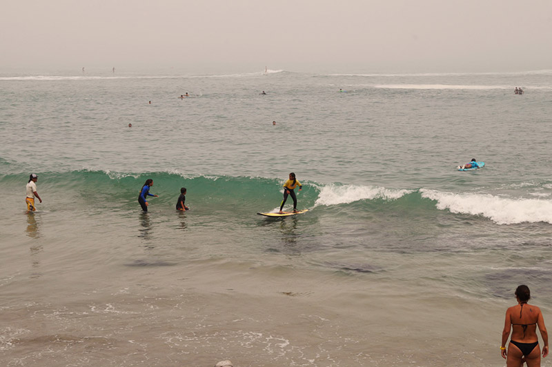 A local girl in Punta Hermosa learning to surf.