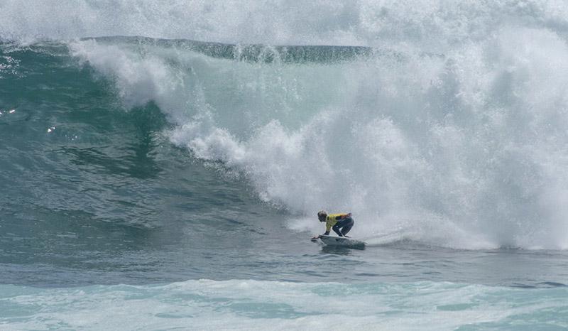 """""""Lele"""" Usuna bottom turning ahead of a big wall ahead. Photo: ISA/Michael Tweddle"""