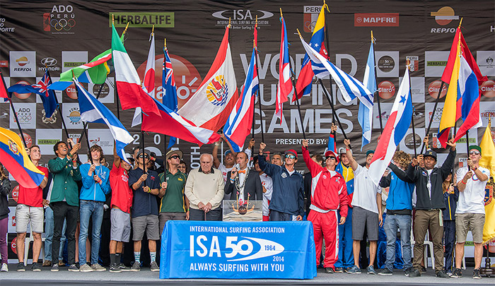 Current ISA President Fernando Aguerre (center), joined by the first ISA President, Peruvian Eduardo Arena, who founded the ISA in 1964, amongst the flags of the 22 National Teams, declared the Claro ISA 50th Anniversary World Surfing Games officially open. Photo: ISA/Michael Tweddle